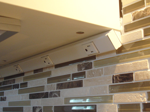 October 2012 undercabinet outlets instead of traditional outlets along